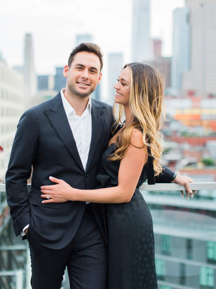 Couple in NYC for engagement pictures with great hair.
