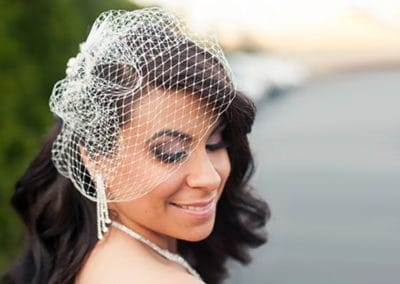Bridal hairstyle with veil for Bride at the Viana Hotel in Long Island NY