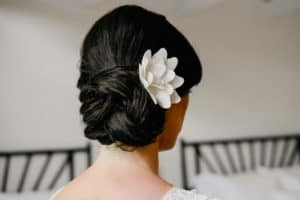 wedding updo with flower for Hamptons wedding at East Hampton Pointe in Long Island NY