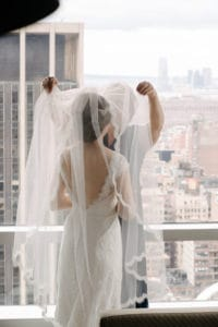 Bridal updo hairstyle with veil overlooking NYC skyline