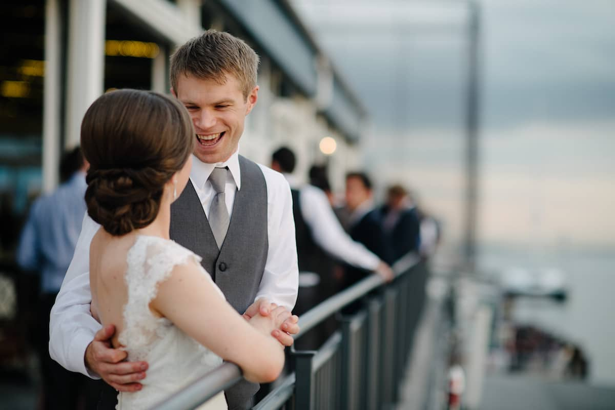 Bride and groom with styled hair sharing a moment on the New York ship galley.