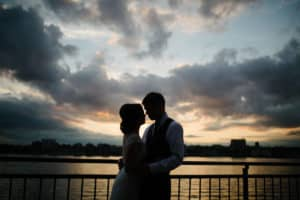 Updo hairstyle for bride at Sunset terrace at Chelsea Piers in NYC
