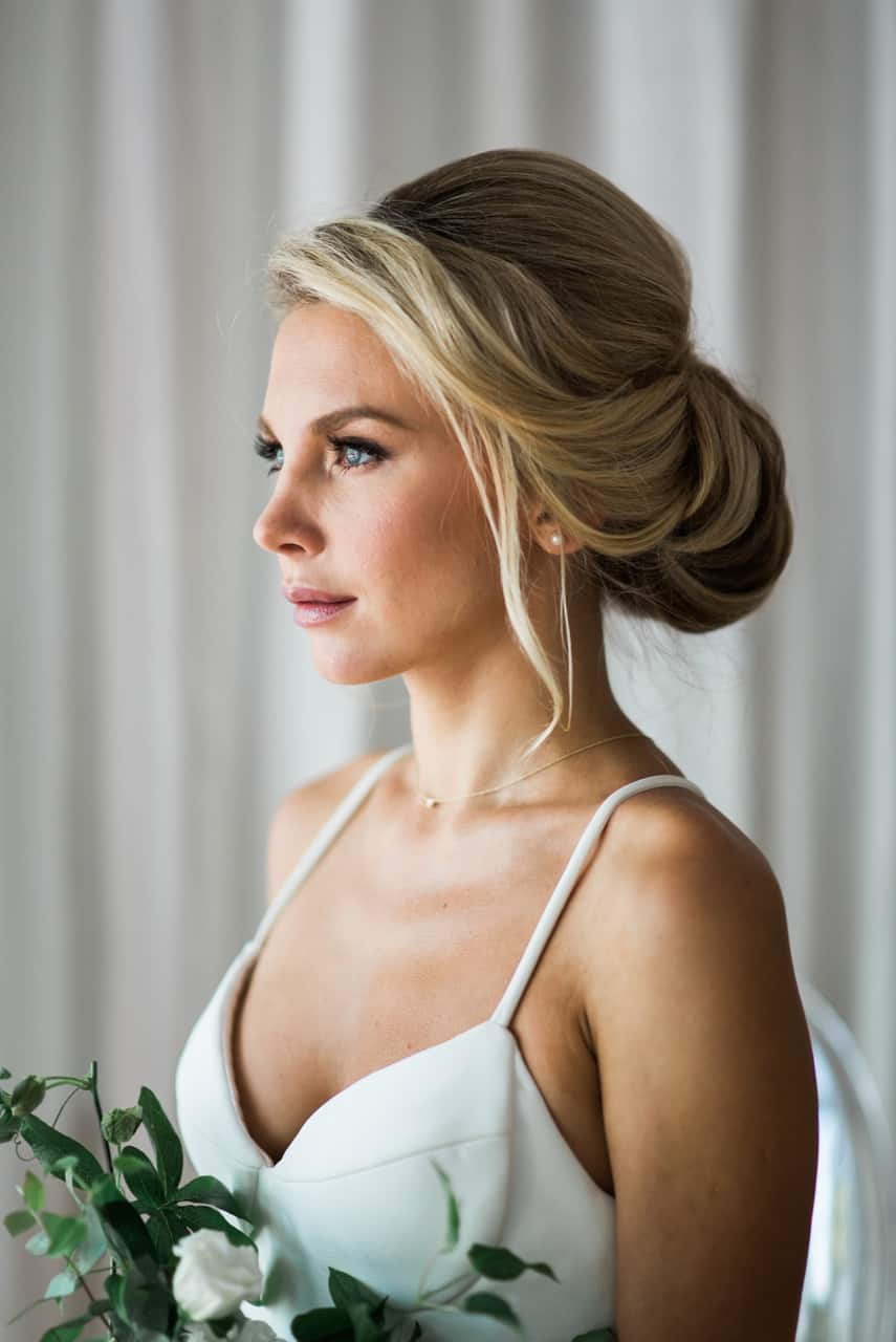 Beautiful bride in New York City with an up-do and messy knot hair style.